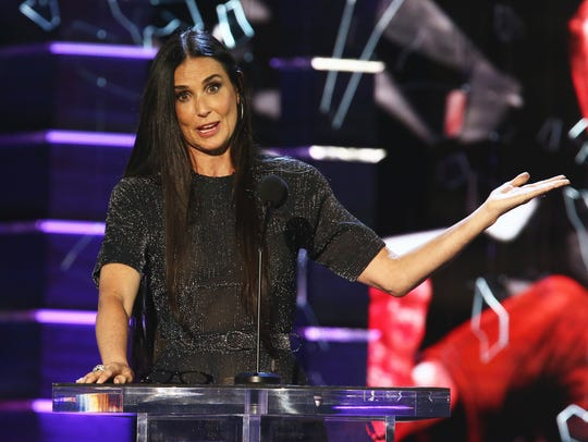 Surprise! Willis' ex-wife Demi Moore appeared to make