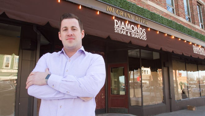 Diamonds Steak and Seafood owner Adam Merkel stands in front of his downtown Howell restaurant in this photo taken Friday, February 3, 2017.