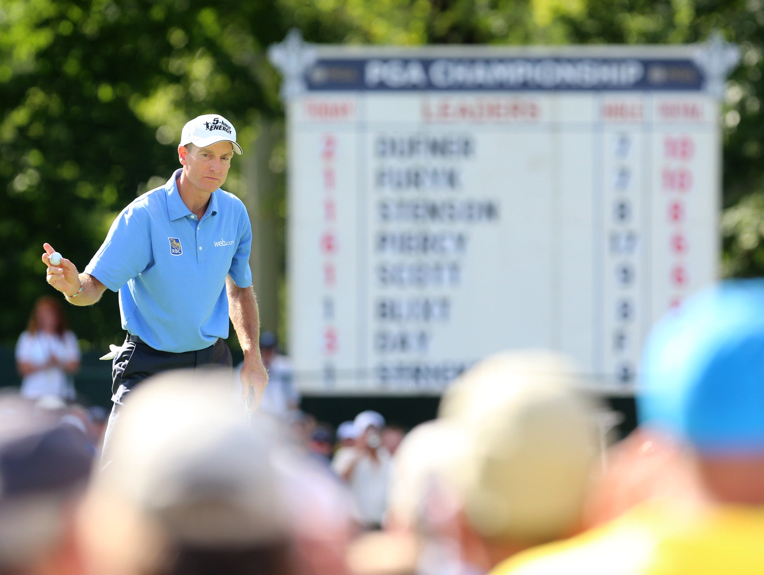 Jim Furyk waves to the gallery after putting out on the No. 8 hole.