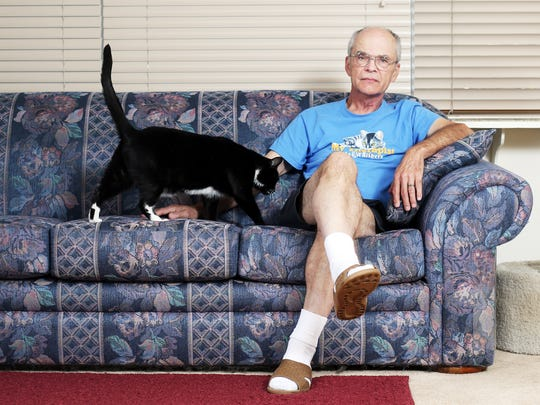 George Piter uses his cats to provide therapy for patients at Salem Hospital. Here is Junior.