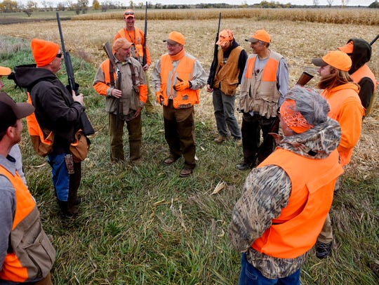 A group of pheasant hunters led by Andy Beedle talk