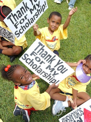 Children from the Joshua Christian Academy in Jacksonville show their signs as they take part in a rally celebrating the Florida Tax Credit Scholarship Program.