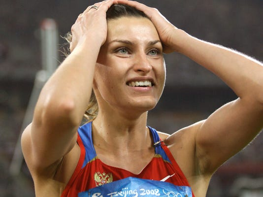 FILE - In this Aug. 23, 2008 file photo Russia's Anna Chicherova reacts after making a clearance in the final of the women's high jump during the athletics competitions in the National Stadium at the Beijing 2008 Olympics in Beijing. On Thursday, Oct. 6, 2016 Chicherova was stripped of bronze medal from 2008 Olympics in a doping case.  (AP Photo/David J. Phillip, file)