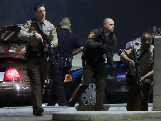 Police mobilize in the parking lot of the Ferguson