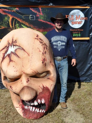 Ronnie Bonadeo stands at the haunted house entrance.