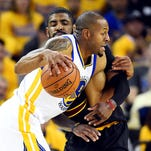 Andre Iguodala drives to the basket against Kyrie Irving during the first quarter of Game 5 of the NBA Finals at Oracle Arena.
