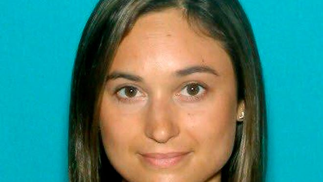 This undated driver license photo released by the Worcester County District Attorney's Office shows Vanessa Marcotte, of New York, whose body was found Sunday night, Aug. 7, 2016, in the woods about a half-mile from her mother's home in the town of Princeton, Mass., about 40 miles west of Boston.