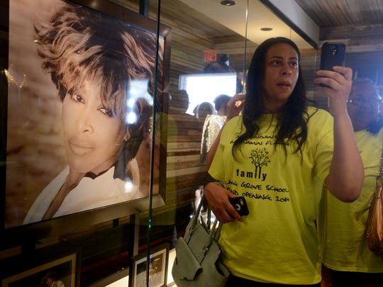 April Williams takes photos with her phone inside the Flagg Grove School and Tina Turner Museum on Friday at the West Tennessee Delta Heritage Center in Brownsville.