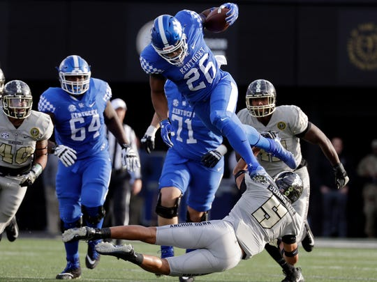 Benny Snell leaps over a Venderbilt defender in Saturday's game.