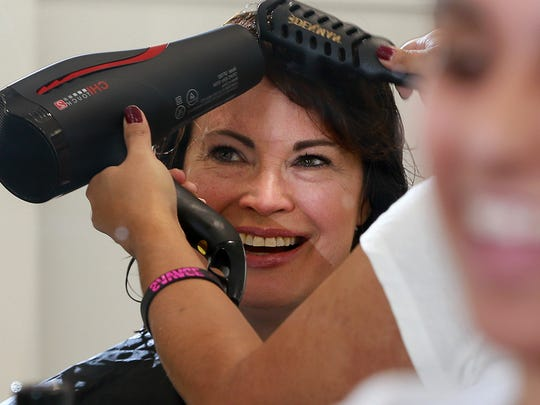 Laurie Patterson, of Boise, Idaho, gets a style and cut on Wednesday at the new Ulta Beauty inside the Animas Valley Mall in Farmington.