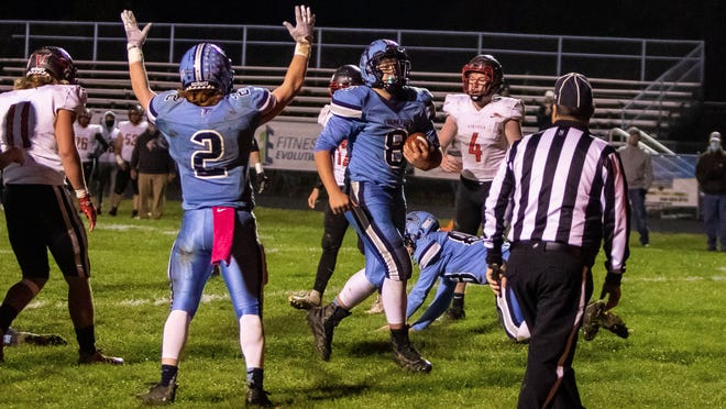 Peyton Clark (2) signals a TD as Brock Robinette brings the ball during the Frankfort-Petersburg game Friday. Tribune photo by Lee Brown/knobley.com