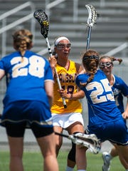 Salisbury attack Hannah Young (18) looks to shoot against Hamilton College in the NCAA Playoffs on Sunday afternoon at Sea Gull Stadium.