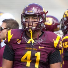 ASU linebacker Viliami Latu looks on during the ASU football spring game at Sun Devil Stadium in Tempe on Saturday, April 19, 2014.