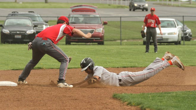 Shelby's Blaise Caudill tags out Mansfield Senior's Jakobe Reese at second base during a sectional semifinal game at home on Wednesday.