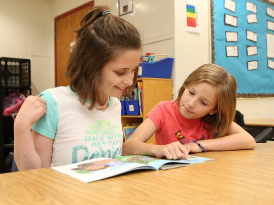 Ainsley Jones, 10, right, reads with Julia Cohen in Joyce Kinches' special class at the Ward Elementary School in New Rochelle, May 5, 2017.