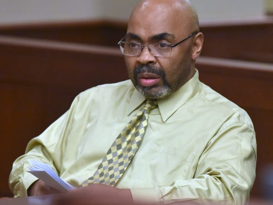 Defendant Wynton Dixon reacts as his case is bound
