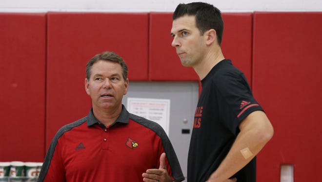University of Louisville acting athletic director Vince Tyra, left, chats with interim men's basketball coach David Padgett team during practice.  Tyra was named to the postition while current athletic director Tom Jurich is on administrative leave.Oct. 4, 2017