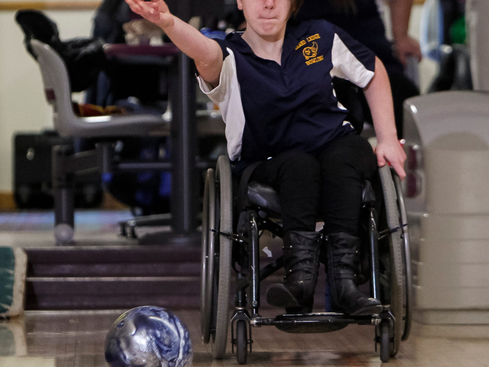 Grand Ledge Bowling team member, sophomore Caitlyn Wells sends the ball down the lane at Royal Scott Tuesday. Wells has spina bifida, and has been in a wheelchair her entire life.