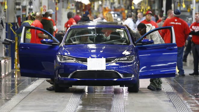 In this March 14, 2014 photo, a 2015 Chrysler 200 automobile moves down the assembly line at the Sterling Heights Assembly Plant in Sterling Heights.
