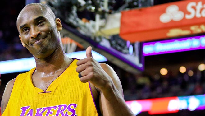 Kobe Bryant (24) gives a thumbs up after a video presentation of his career during the first quarter of a game against the New Orleans Pelicans on April 8.  Bryant will play the final game of his NBA career Wednesday.