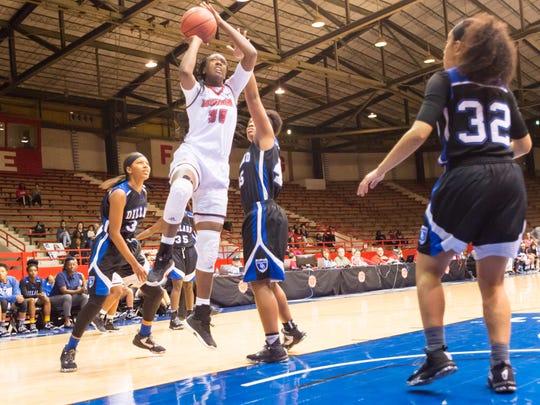 UL's Brittney Myles shoots the ball against Dillard