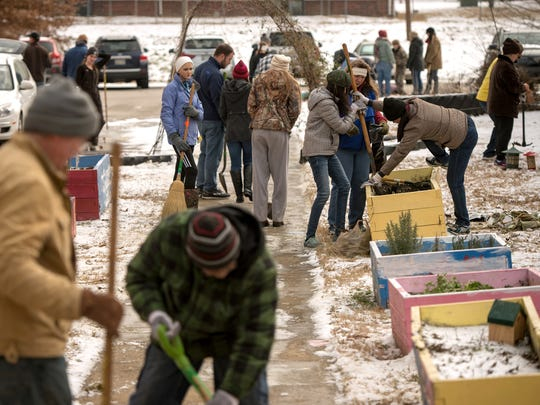 January 15, 2018 - Volunteers from Buckman Labratories, Clean Memphis, and the Wolf River Conservancy tend to raised beds in the garden of Springdale Elementary school during a cleanup event as part of the MLK Day of Service honoring Martin Luther King, Jr. on the anniversary of his birth. (Brandon Dill/Special to The Commercial Appeal)