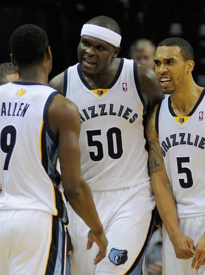 The Grizzlies surround Tony Allen (9) after his key shot late in Game 3 Thursday against the Thunder.