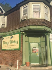 Nancy Whiskey serves visitors in the north Corktown