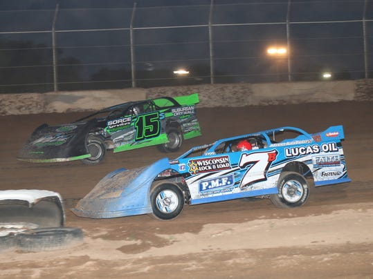 #7b Tim Buhler raced to earn his second feature win of the season at the Ply.jpg