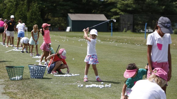 Eloise Schultz, 6, of Rye practices her swing at the