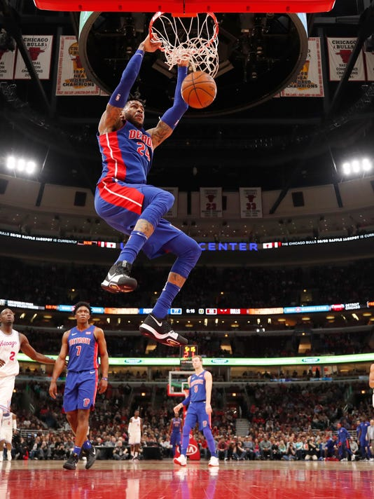 Detroit Pistons forward Eric Moreland (24) dunks the basketball against the Chicago Bulls during the second half of an NBA basketball game in Chicago, Wednesday, April 11, 2018. (AP Photo/Jeff Haynes)