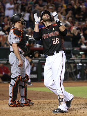 Diamondbacks' J.D. Martinez (28) points to the sky after hitting a solo home run against the Marlins in the fifth inning at Chase Field in Phoenix, Ariz. on Sept 23, 2017.