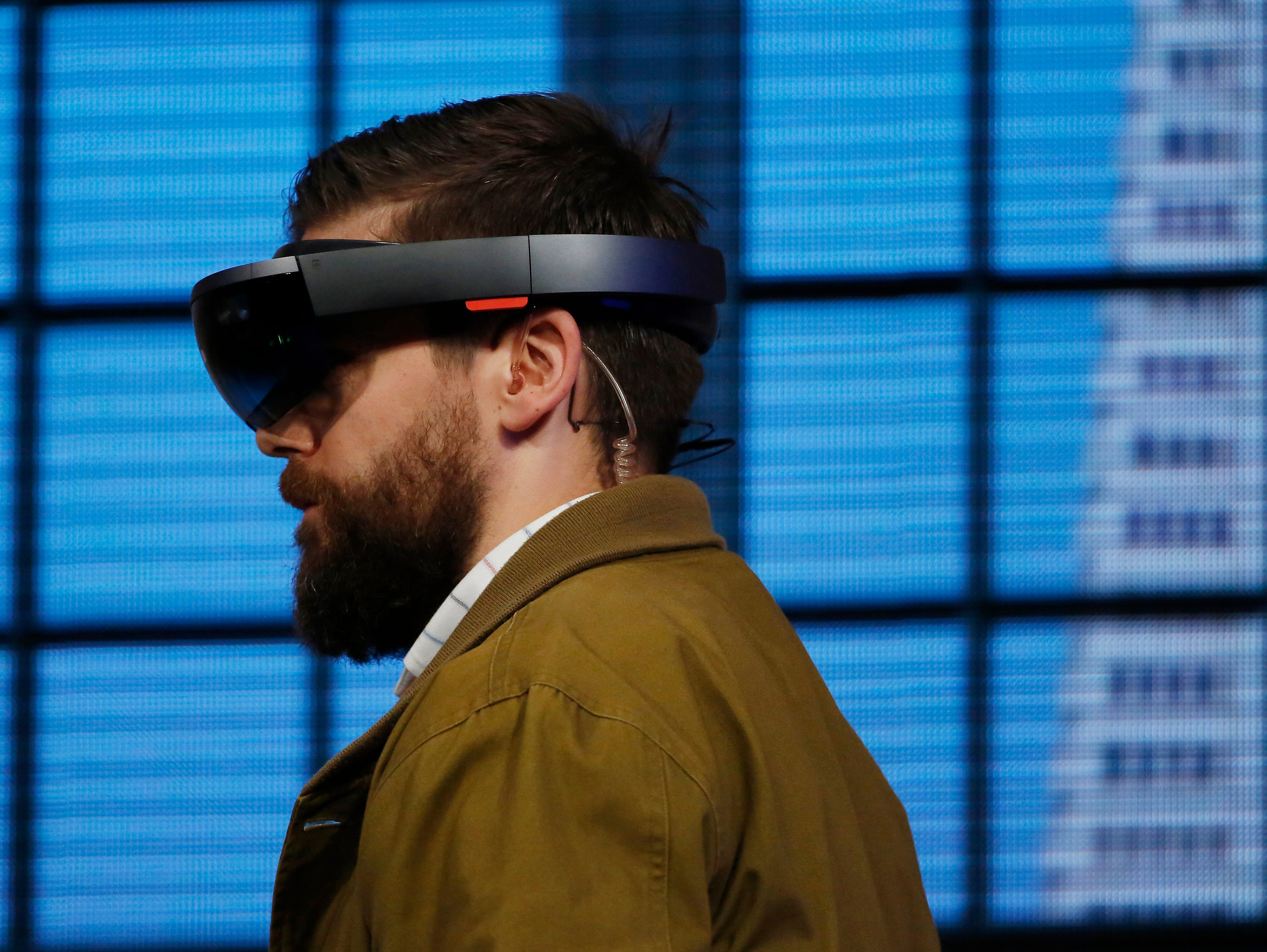 The Microsoft HoloLens augmented reality headset is demonstrated on stage during the 2015 Microsoft Build Conference.