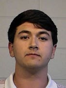 This Nov. 8, 2015 photo provided by Tuscaloosa Police Department shows Brandon James Williford. Several police officers were suspended with pay Monday, Nov. 9, 2015, after videos posted online showed officers using a stun gun and baton to break up a post-football game party and arrest Williford and two other University of Alabama students. (Tuscaloosa Police Department via AP)