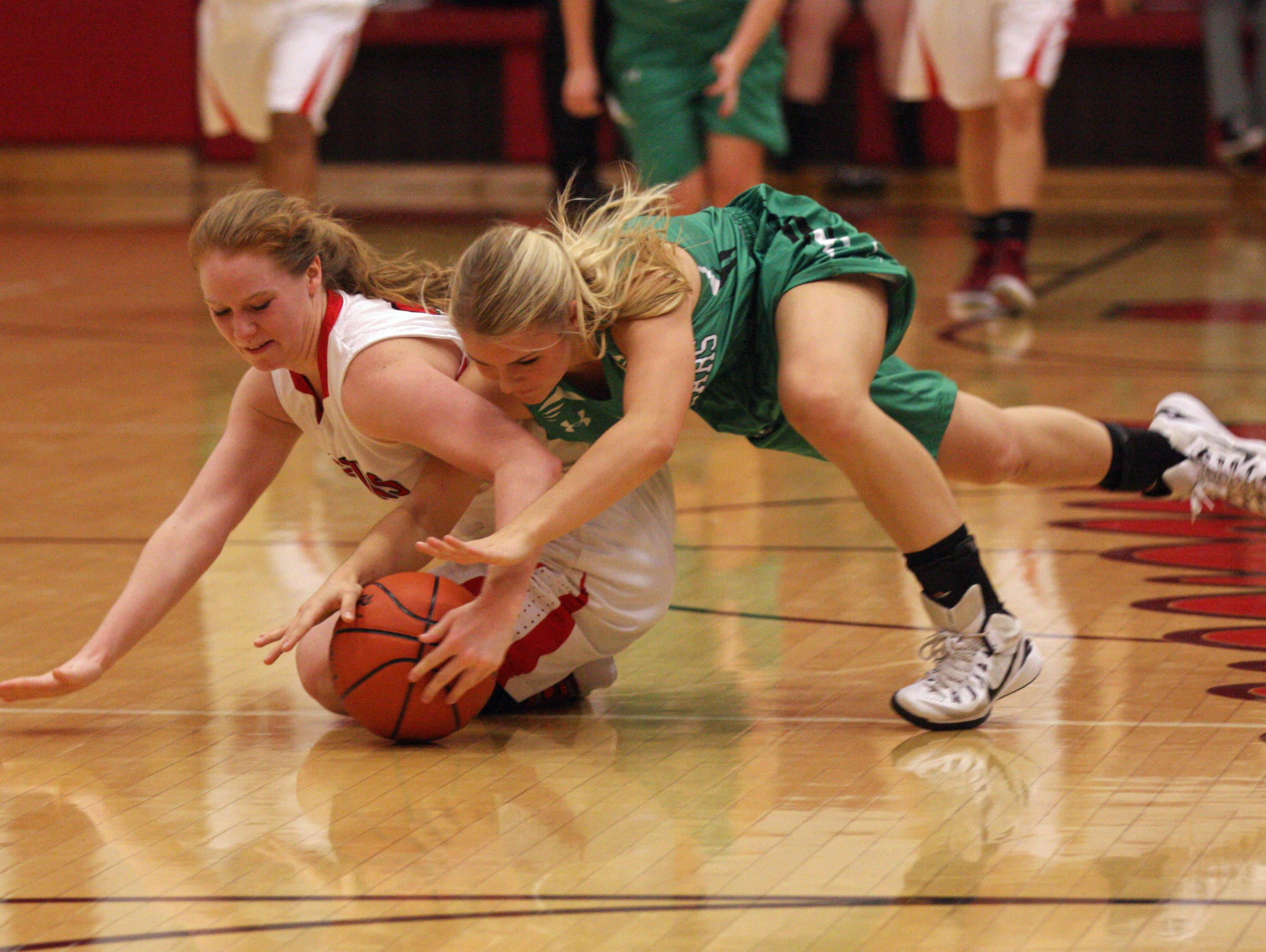 Port Clinton's Marissa Day and Margaretta's Kristen Yost fight for a loose ball Wednesday at Port Clinton.
