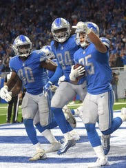 The Lions' (from left) Jarrad Davis, Ziggy Ansah and