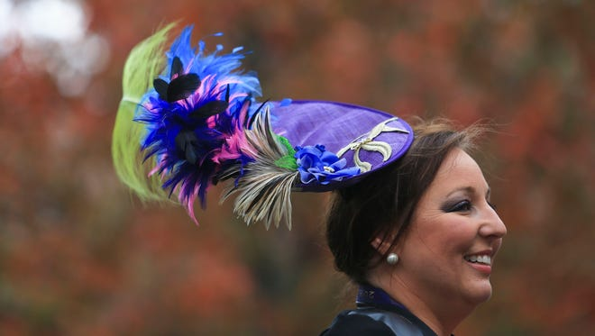 Margalee Conlee smiles while talking with friend Melissa Turner while at Keeneland Friday morning. Conlee makes her own fascinators and runs a hat-making business called Head Turners.