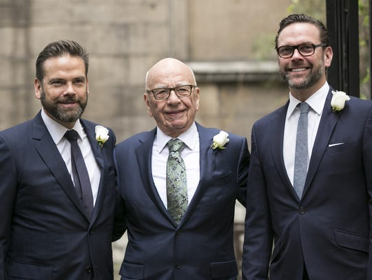 Australian-born US media mogul Rupert Murdoch is accompanied,