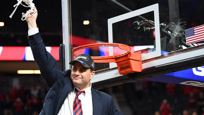 Mar 11, 2017: Arizona Wildcats head coach Sean Miller swings a net around in celebration after the Wildcats defeated the Oregon Ducks 83-80 in the Pac-12 Conference Championship game at T-Mobile Arena.