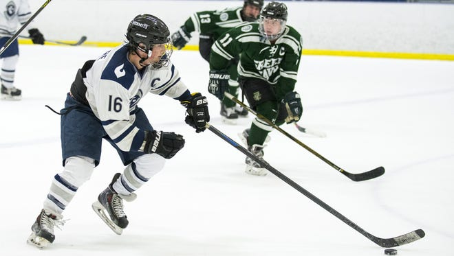 St. Augustine's Carson Briere (16) carries the puck in a game against Delbarton Thursday, Feb. 2 at Igloo Ice Rink in Mt. Laurel. The game ended 1-1.
