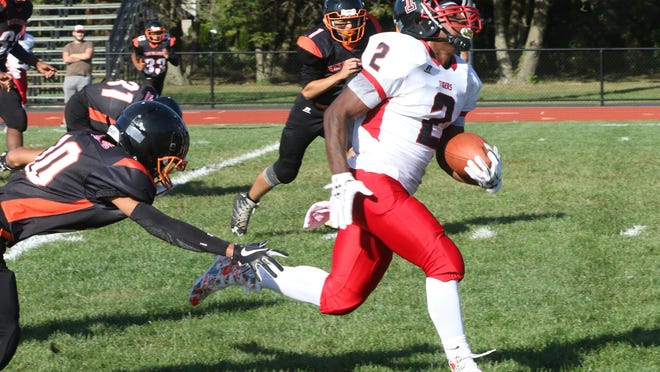 Tolman running back Jeremiah Edwards breaks through West Warwick's defense and runs in for a touchdown last fall. Will football be played this fall in Rhode Island? Answers could come as early as Wednesday.