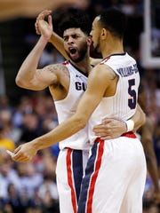 Gonzaga guard Josh Perkins, left, celebrates with teammate Nigel Williams-Goss after a win over West Virginia in the Sweet 16 Thursday night in San Jose.
