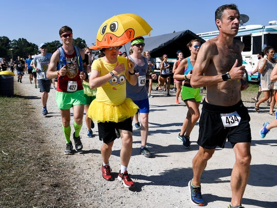 Wade Wynn from Nashville runs as a duck in the Roo