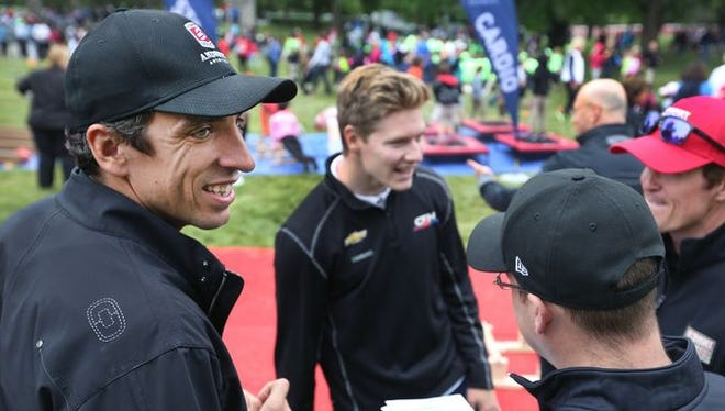 Justin Wilson (left) will be on the hearts and minds of IndyCar drivers this weekend at Sonoma.