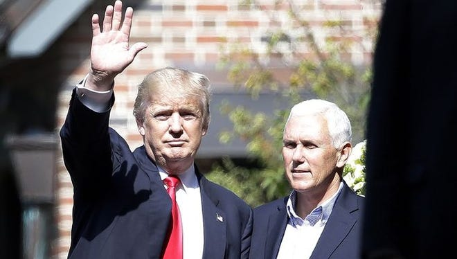 Donald Trump, the presumptive Republican nominee for president, waves to the media after meeting with Indiana Gov. Donald Trump at the Governor's Residence on July 13, 2016.
