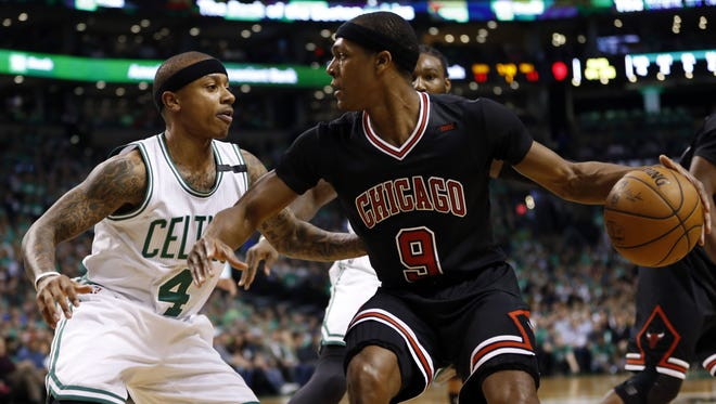 Chicago Bulls point guard Rajon Rondo (9) is guarded by Boston Celtics point guard Isaiah Thomas (4) during the first quarter in game two of the first round of the 2017 NBA Playoffs at TD Garden.
