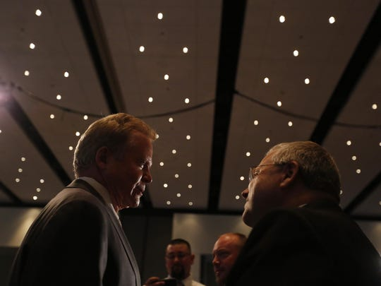 Democrat Jim Webb talks with guests Friday during the Iowa Democratic Party Hall of Fame Celebration in Cedar Rapids.