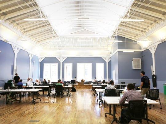 Employees of start-ups work at Union Hall, Cincinnati's