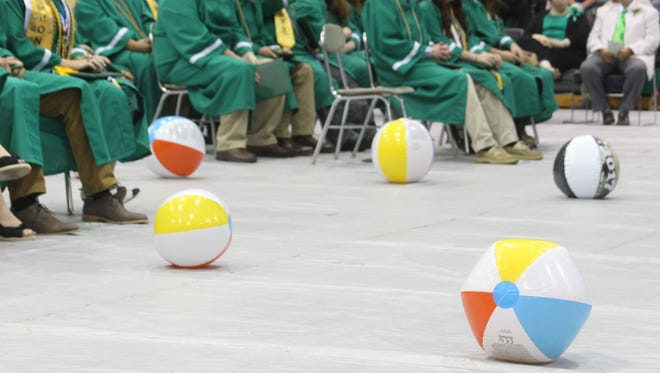 Houston County High School student smuggled beach balls into the school and threw them during the ceremony on May 26, 2017.