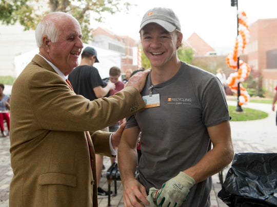 John Tickle greets Austin Reynolds of UT Recycling